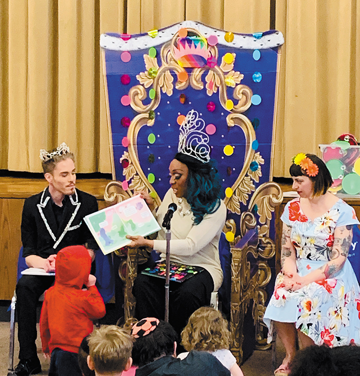 Zedek. Dylan West, left, is also a drag queen storyteller; Huntington Woods Children's Librarian Joyce Krom is on the right.