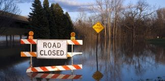 Michigan had 100-year floods not long ago, and here's proof: a Road Closed sign, half submerged with what looks like a lake behind it. It's no lake, just a parking lot. Shot just before dusk,