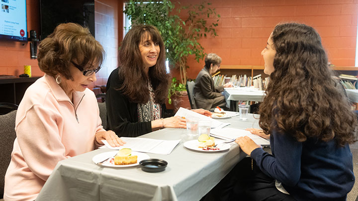 Chabad High School student and other women study Torah together