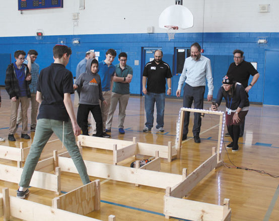 Jewish students learning about robotics