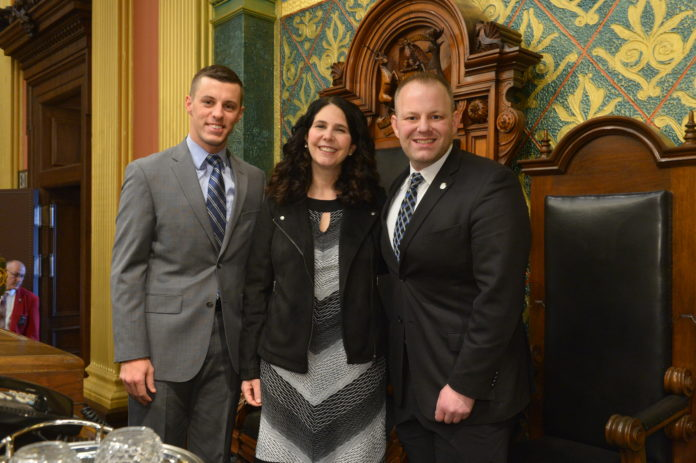 State Rep. Ryan Berman of Commerce Township welcomed Rabbi Marla Hornsten to the state capitol to lead the invocation Wednesday, Feb. 5, for the Michigan House of Representatives. Joining them at the rostrum is Speaker of the House Lee Chatfield.