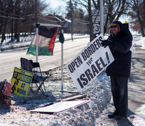 Witness for Peace group protesting outside Beth Israel in Ann Arbor