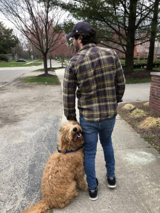 Magglio and his owner Jake Serwer practice social distancing on a walk in Birmingham.