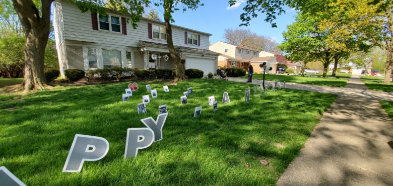 "Family members also decorated the lawn with ""Happy Anniversary"" signs."