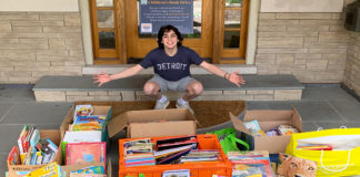 Cooper Schoenberg with some of the books he's collected.