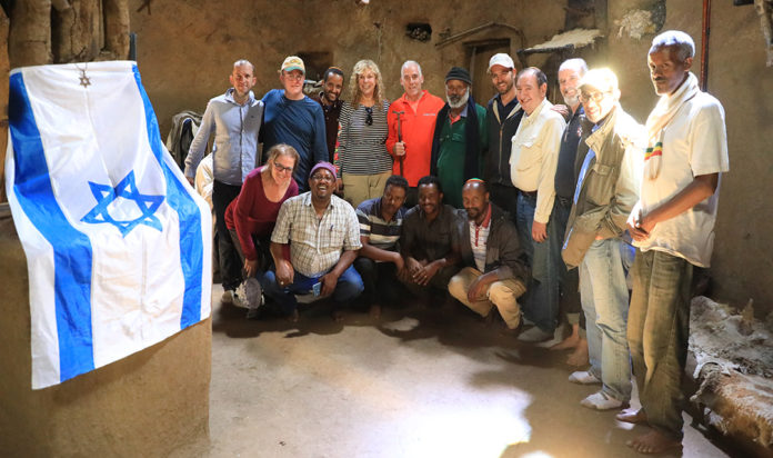 The Friends delegation plus Ethiopian Beta Israel leadership inside the synagogue at the Jambaria gedam