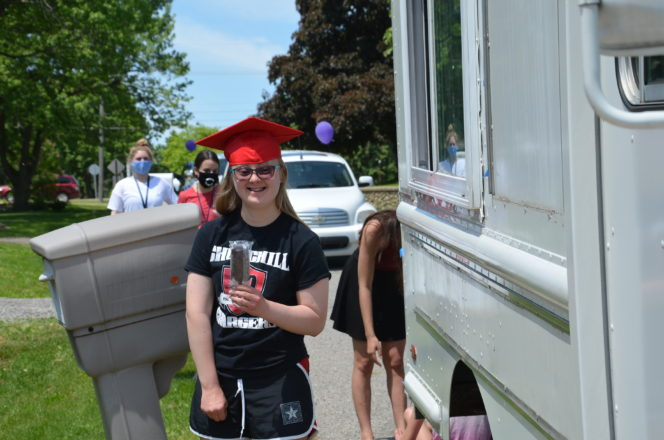 Hannah Craft gets some ice cream from the Friendship Circle ice cream truck