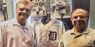 Fred Willard and Larry Lawson in front of the Hank Greenberg display at Comerica Park in 2008.