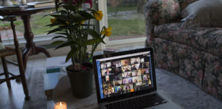 A family takes part in a shiva call, a Jewish mourning period, in a Zoom videoconference.