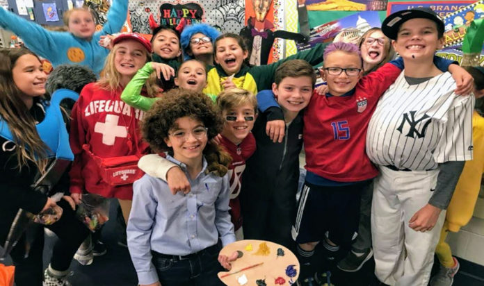 Judah Falik (Bob Ross) and his classmates.