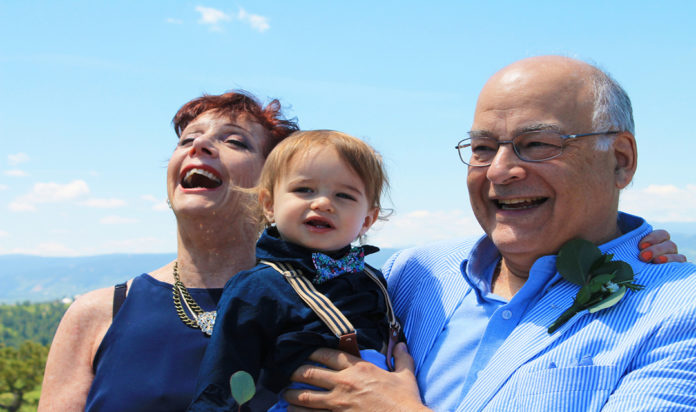 Phil Ross and wife Debbi with one of their two grandchildren