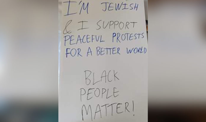The sign Menachem Roetter carried.
