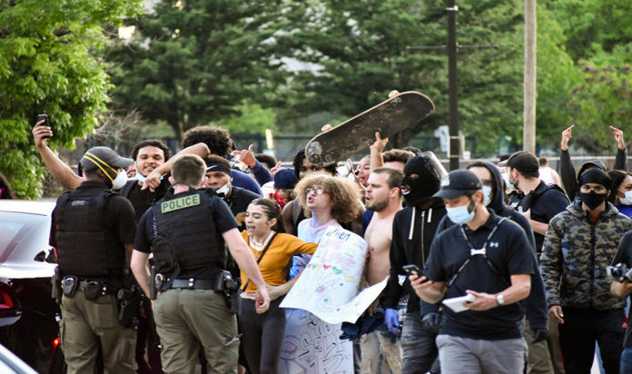Protesters and police clash in Detroit during demonstrations following the May 25 police killing of Minneapolis man George Floyd.