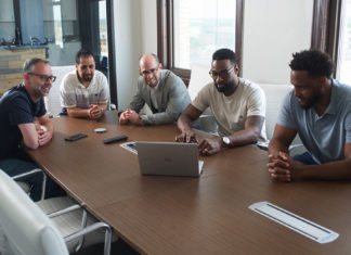 The Jewish PRIMITIV co-founders, Jared Bundgaard, Adi Twina and Josh Weinberg, with Calvin Johnson Jr. and Rob Sims, in their Detroit office.