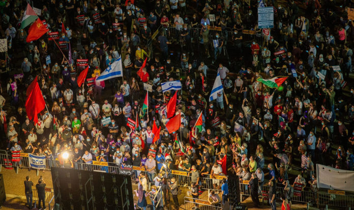 Thousands demonstrate in Tel Aviv's Rabin Square against Prime Minister Benjamin Netanyahu's plan to annex parts of the West Bank on June 6, 2020.
