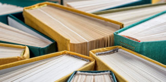 Hardcover books close up, selective focus