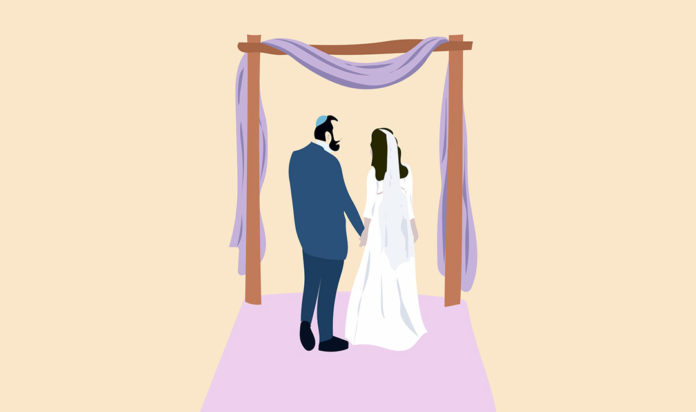 A Jewish couple under the wedding canopy, or chuppah