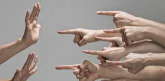 Group of hands with pointing finger