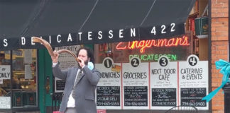 Rabbi Josh Whinston in front of Zingerman's Deli