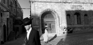 A Jew and a Christian pass on an Israeli street.