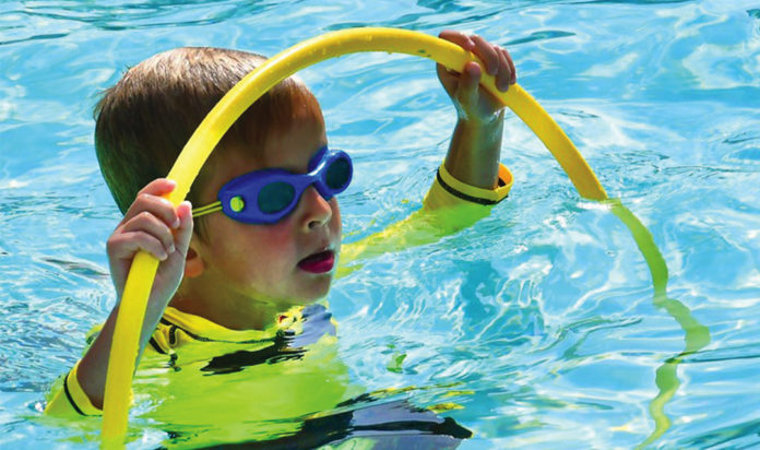 Benji Schostak of West Bloomfield has fun in the pool at Camp Willoway.