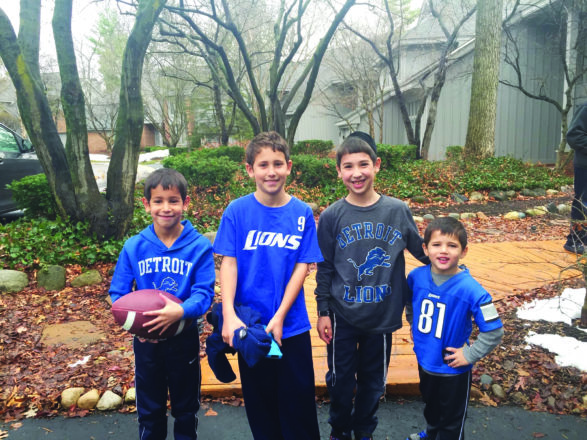 Jake and Ari Schon of West Bloomfield/Huntington Woods, Zevi Beneson of Passaic, N.J. and Noam Dorfman of Boca Raton, Fla., ready for the Thanksgiving Day Lions game in 2015.