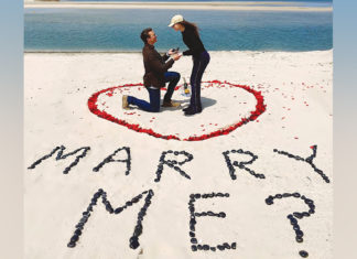 Judah Schulman proposes to Toby Milstein on a beach on Long Island.