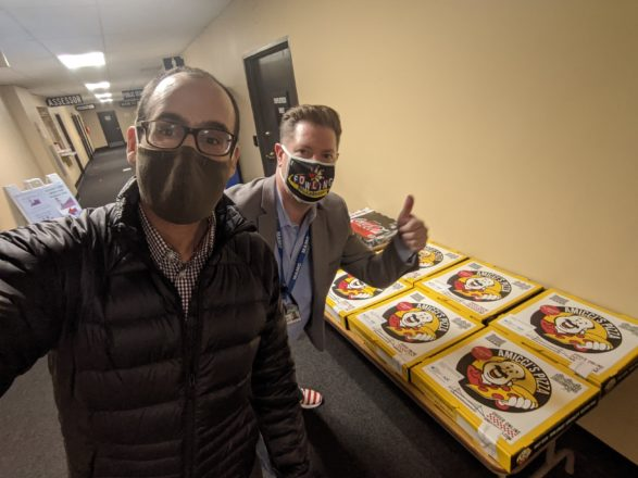 JCRC/AJC Vice President Ruby Robinson with August Gitschlag, City Clerk for Hamtramck, delivers pizza to poll workers in Hamtramck.