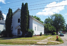 The shul resembles a house on the corner.