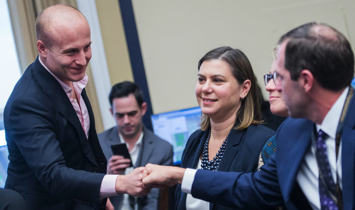 Max Rose, left, and Elissa Slotkin, center, seen in the Rayburn Building in Washington, D.C., after being elected in 2018. Both are in tight races to retain their seats.