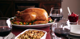 A Thanksgiving table is set with the traditional holiday favorites -- and some wine to wash them down.