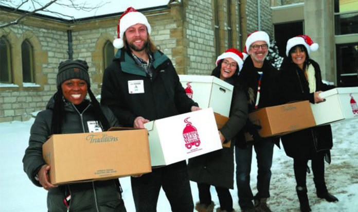 Shawn Hunt of Clinton Township, Oliver and Taylor Beardsall of Novi, and David and Susie Kamen of White Lake pick up Meals on Wheels at Christ Church to deliver to families in 2018.