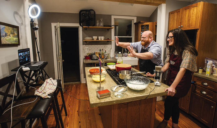 Rabbi Jeff Stombaugh and his wife, Stephanie Belsky, of Royal Oak demonstrate how to make sufganiyot over Zoom.