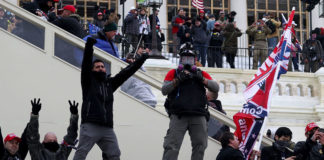 Protesters gather on the U.S. Capitol in Washington, Jan 6, 2021. Pro-Trump protesters entered the building after mass demonstrations.