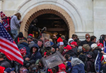 Police use tear gas around Capitol building where pro-Trump supporters riot and breached the Capitol in Washington DC on Jan. 6, 2021.