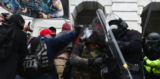 Riot police push back a crowd of supporters of US President Donald Trump after they stormed the Capitol building in Washington, DC on Jan. 6, 2021.