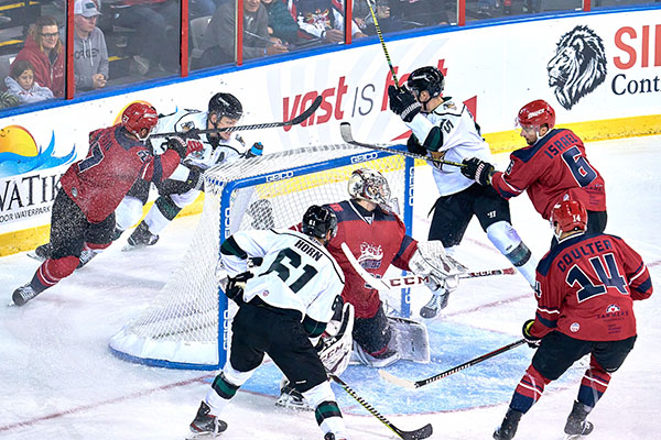 Rapid City Rush defenseman Eric Israel (6) keeps a Utah Grizzlies player away from the net during a Dec. 12 game.