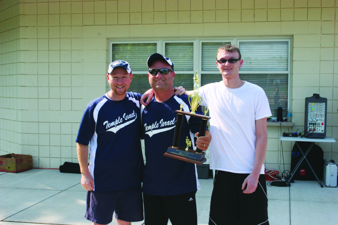 Brad Kallen (center) of Temple Israel No. 3 holds the Jeff Fox Sportsmanship Award presented annually by the Inter-Congregational Men's Club Summer Softball League. With Kallen are Temple Israel No. 3 manager Elon Friedman and Adam Fox, Jeff's son.