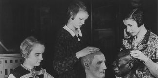 Students at the Berlin School for the Blind examine racial head models circa 1935. Students were taught Gregor Mendel's principles of inheritance and the purported application of those laws to human heredity and principles of race.