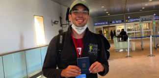 Michael Vivier, 25, shows off his new immigrant card upon arrival at Tel Aviv's Ben Gurion Airport, Sept. 2, 2020.
