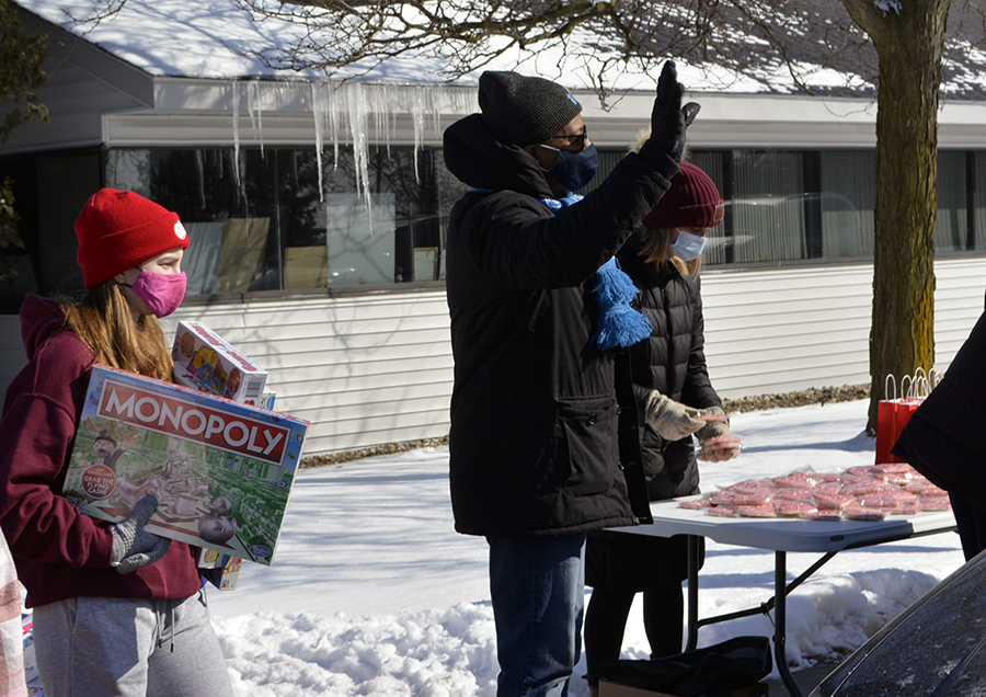 Volunteer Mariah Shaver, 16, from Highland, Mich., helps distribute gifts to the kids.