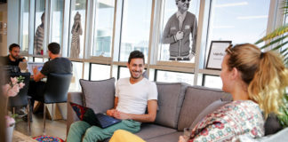 Some immigrants to Israel with U.S.-based employers find places outside the home to work, including a co-working space run by Nefesh B'Nefesh in Tel Aviv. Before the pandemic hit, the co-working hub operated without social distancing restrictions.