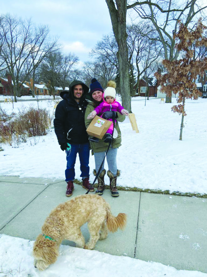 David, Kate and 1½-year-old Shoshi Zenlea of Huntington Woods, with their furry friend.