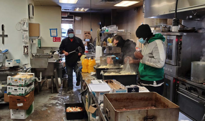Kosher Palate, a kosher restaurant in Dallas, prepares thousands of free hot meals to serve to Orthodox families affected by power outages during Winter Storm Uri, Feb. 17, 2021.