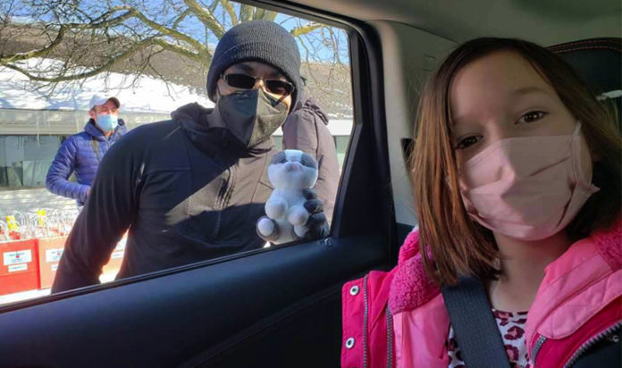 The only thing better than receiving gifts at the Drive-By was when 7-year-old Ember Miller of St. Clair Shores had the chance to see Sensei Michael, one of KKC's martial arts therapists, live versus on Zoom.