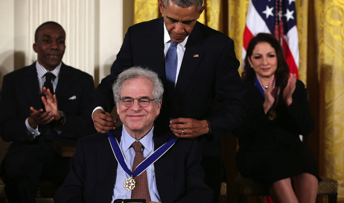 Violinist Itzhak Perlman, seen here receiving the Presidential Medal of Freedom from President Barack Obama in 2015, was among those participating in a kickoff event for Jewish Disability Advocacy Month on Feb. 3, 2021.