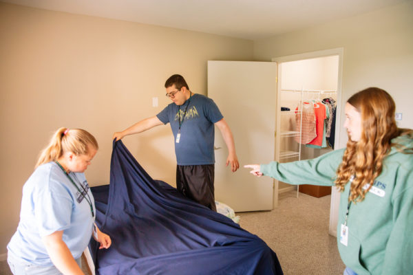 Young adults practice independent living skills in a safe and supervised environment at Meer Apartments in West Bloomfield.