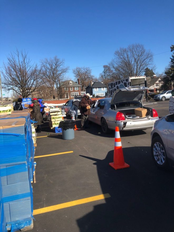 Volunteers pack cars with donations on March 4