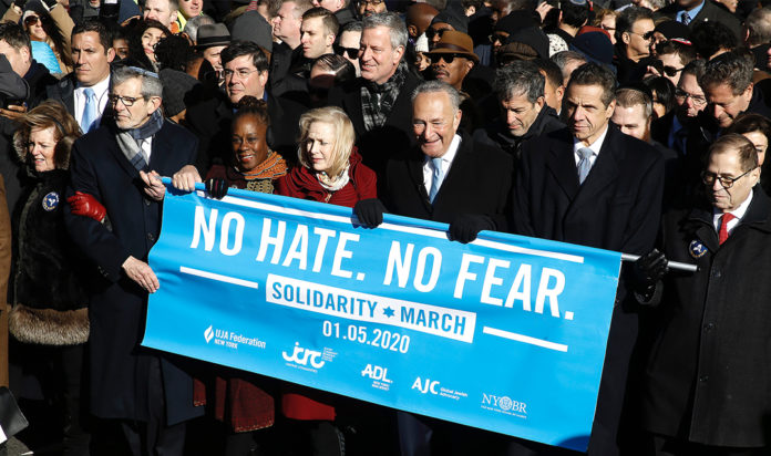 From right: Rep. Jerrold Nadler, Gov. Andrew Cuomo, Sen. Chuck Schumer, Mayor Bill de Blasio and Sen. Kirsten Gillibrand hold a banner at the march against anti-Semitism in New York City, Jan. 5, 2020.