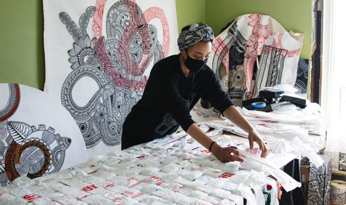 Olivia Guterson works on the installation that will be on view in front of MOCAD.